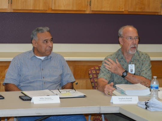 Tulare hospital board members Mike Jamaica, left, and