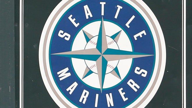 The Mariners logo is seen on a scoreboard in Safeco Field in Seattle.