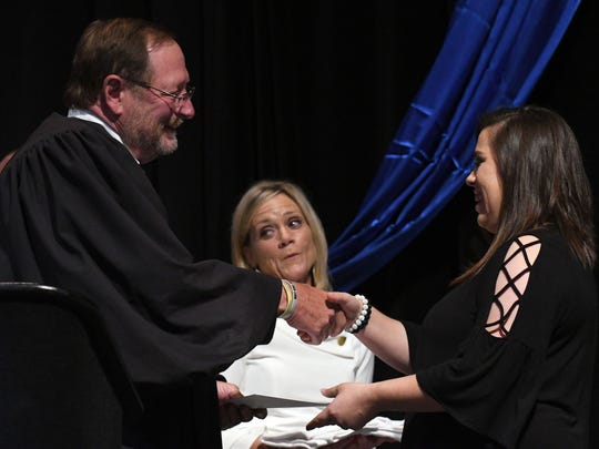 Twelfth Judicial District Circuit Judge Bob Helfrich congratulates graduates at the Forrest/Perry County Adult-DUI-Veteran's graduation on Feb. 29, 2016, at Lake Terrace Convention Center.