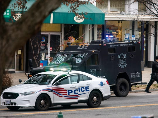 Police surround Comet Ping Pong on Sunday.