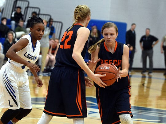 Beech's Mia Dean takes a handoff from Kendra Mueller during first-quarter action at Lebanon.
