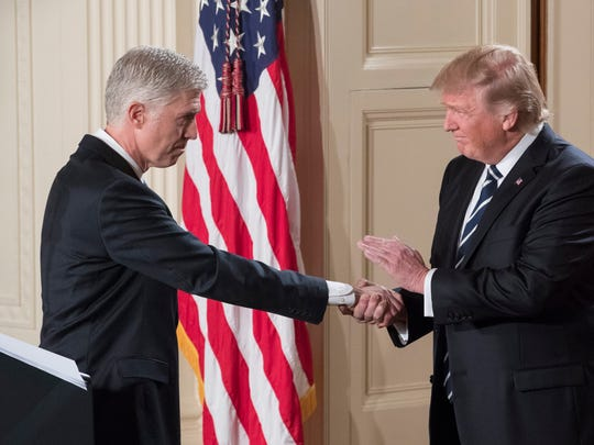 President Trump shakes hands with Neil Gorsuch after announcing his nomination in the East Room of the White House on Jan. 31, 2017.