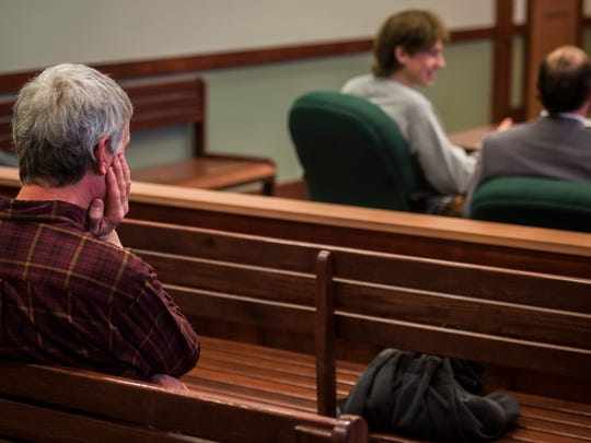 Right, David Sawyer, father of Jack Sawyer, 18, of Poultney, waits for a judge's decision in Vermont Superior Court in Rutland on Tuesday, April 17, 2018, on whether bail or conditions of release should be set for his son, who the state says was planning a school shooting at Fair Haven Union High School. (POOL photo by Ryan Mercer / Burlington Free Press)