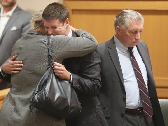 Attorney Jessa Nicholson Goetz hugs Alec Cook after
