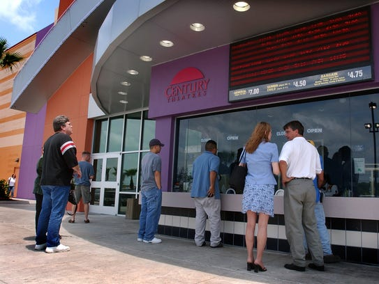People wait in line to buy tickets Thursday afternoon
