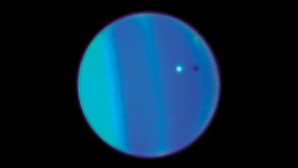 This 2006 image provided by NASA shows an image of Uranus with its moon Ariel, small white sphere, made by the Hubble Space Telescope.