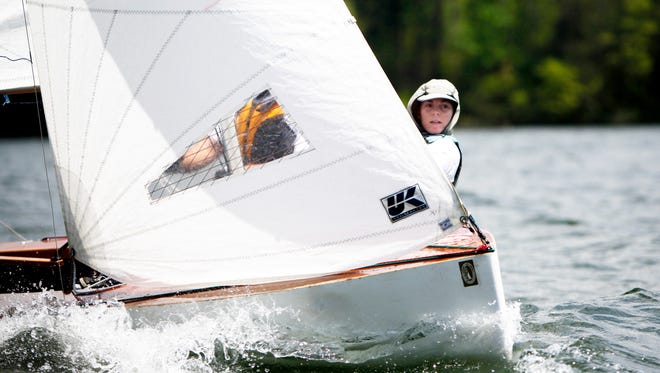 Lacie Wallace leans to oppose the wind during Asheville Sailing Club's Southern Comfort Regatta April 29, 2017.