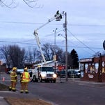 An Xcel Energy crew repaired a sparking power line that caused Division Street in Waite Park to be closed Monday morning.