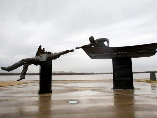 A bronze sculpture by artist David Alan Clark depicts the rescue of a survivor saved from drowning in the Mississippi River by Memphis hero Tom Lee in 1925. (Mike Maple/The Commercial Appeal)