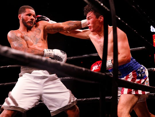 Abie Han exchanges punches with Anthony Dirrell during