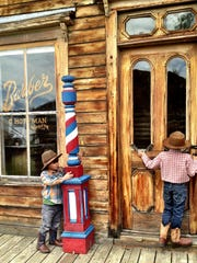 Remy, 4, and Ramzi Maaliki, 7, of Polson check out a barber shop in Nevada City.