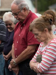 "Kelley Brewer, of Big Sandy, center, prays with community members Monday, October 2, 2017, during a a gathering in honor of Las Vegas shooting victim Sonny Melton in Big Sandy. The 29-year-old was a native of Big Sandy, Tenn., and attended the concert with his wife, Heather. ""I got a call this morning at 4:30 from his grandmother telling us about it,"" said Brewer, Melton's uncle. ""So I've sort of been in shock all day. But I just wanted to say Sonny was a big asset to Big Sandy, along with his family. And we'll miss him."""