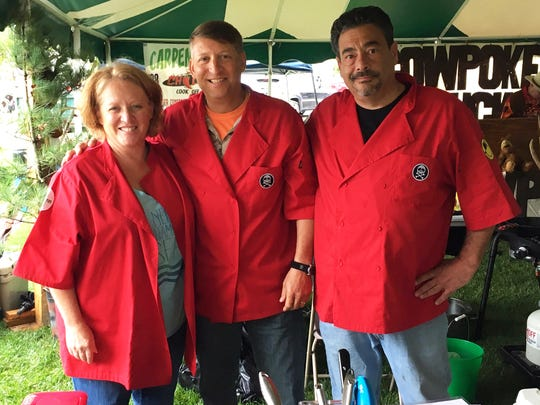 Members of the winning chili cook-off team of Anthony Barone (far right) include wife Maria Barone and brother-in-law Jerry McKeown.