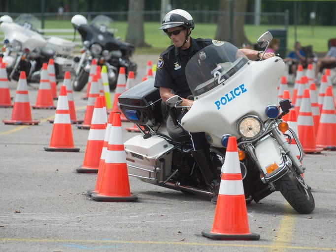 Metro Nashville Officer T.J. O'Brien competes during Hendersonville Police Department Police Motorcycle Rodeo at Drakes Creek Park on Saturday, Aug. 9.
