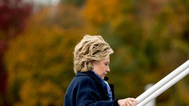 Democratic presidential candidate Hillary Clinton boards her campaign plane at Westchester County Airport in White Plains, N.Y., Friday, Oct. 28, 2016, to travel to Iowa for rallies. (AP Photo/Andrew Harnik)