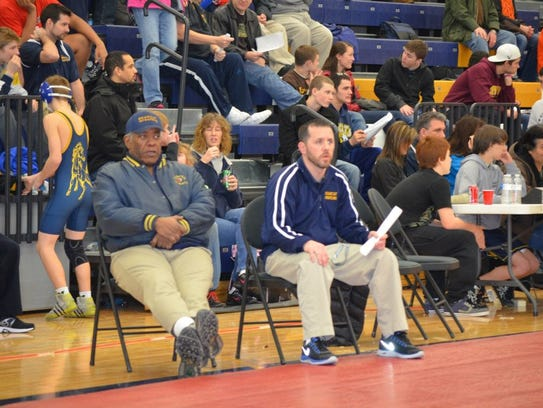 Longtime BCC coach Jeff McGinnis, left, died Monday.