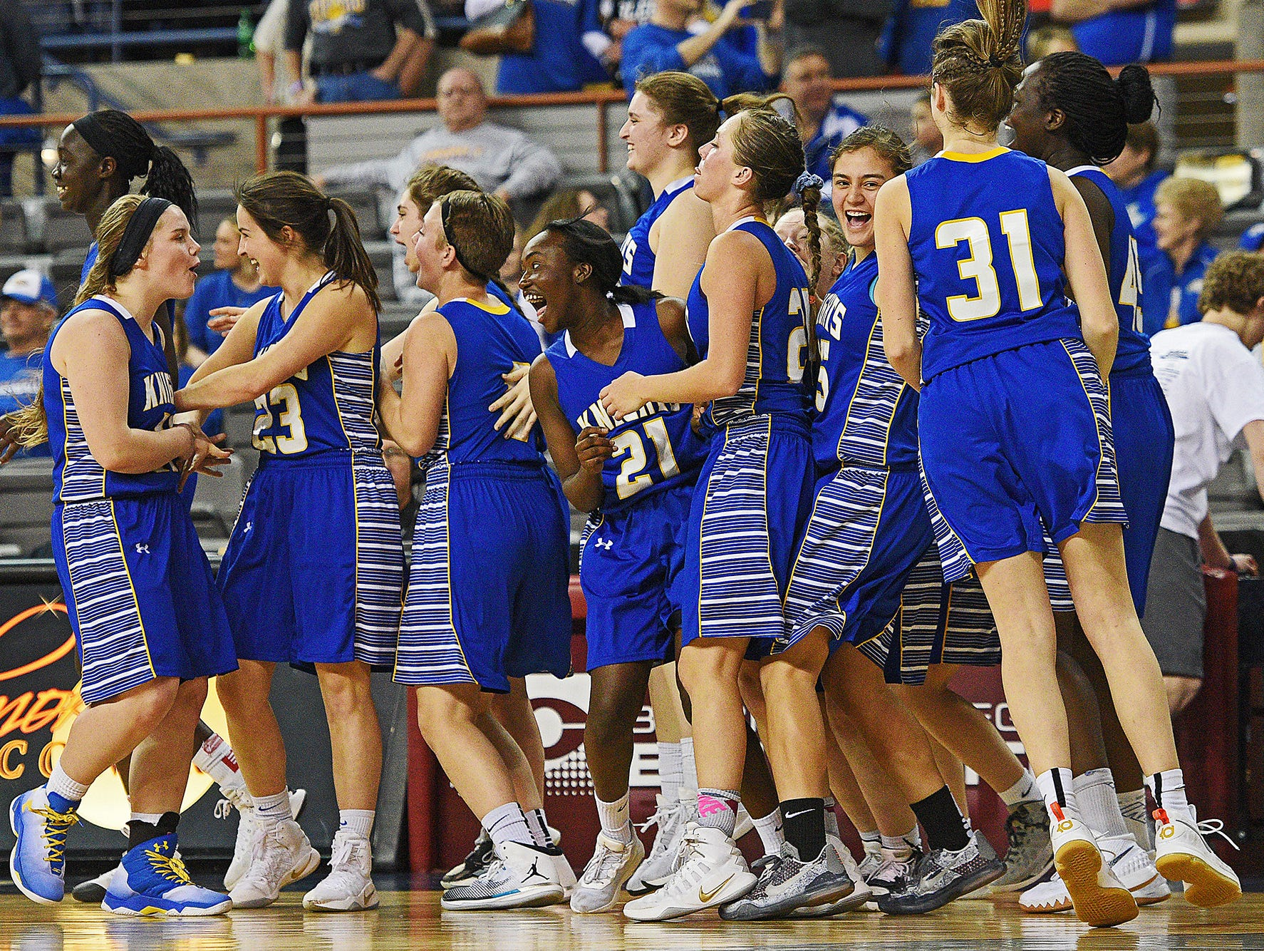 O'Gorman players react after their 37-33 win over Roosevelt in a 2017 SDHSAA Class AA State Girls Basketball quarterfinal game Thursday, March 16, 2017, at Rushmore Plaza Civic Center in Rapid City.