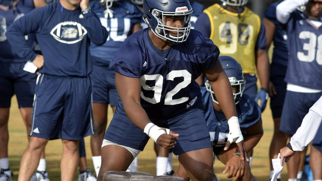 Georgia Southern defensive lineman Raymond Johnson III (92) practices with the defense last season. Johnson  is one of Athlon's first-team selections for the Sun Belt Conference 2020 preseason team.