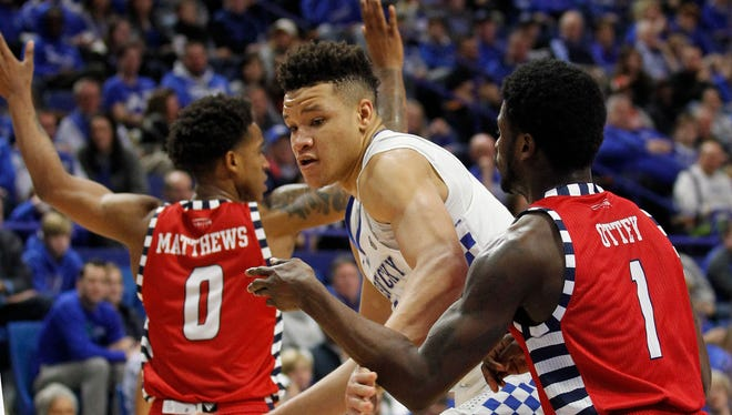 Nov 26, 2017; Lexington, KY, USA; Kentucky Wildcats forward Kevin Knox (5) takes the ball to the basket against Illinois-Chicago Flames guard Marcus Ottey (1) in the second half at Rupp Arena. Kentucky defeated Illinois-Chicago 107-73.