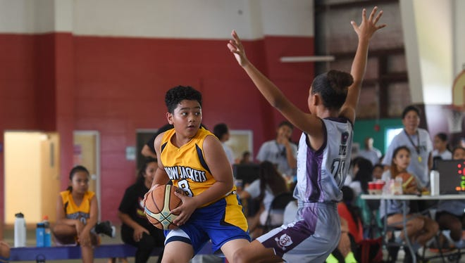 In this June 30 file photo, the Crusaders Grey took on the Yellowjackets Yellow in Guam Youth Basketball Association Drug Free League at Astumbo Gym.