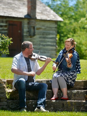Isaac Callender and Louise Steinway play a tune on their fiddles at Gibson Park. Fiddle music arrived in Montana generations before statehood, and Callender and Steinway aim to rekindle local interest in the music and the instrument.