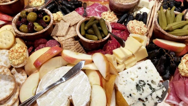 The fun part of a charcuterie board is you can choose such a variety of meats, cheese, different types of bread, crackers and fruit.