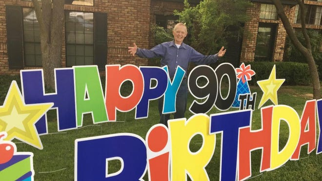 Dr. Gary Garner greets well-wishers as he celebrates his 90th birthday during a surprise parade.
