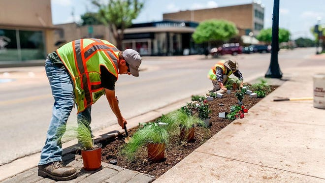 City of Brownwood Parks and Recreation Department employees are pictured making landscaping improvements along Center Avenue in downtown Brownwood.