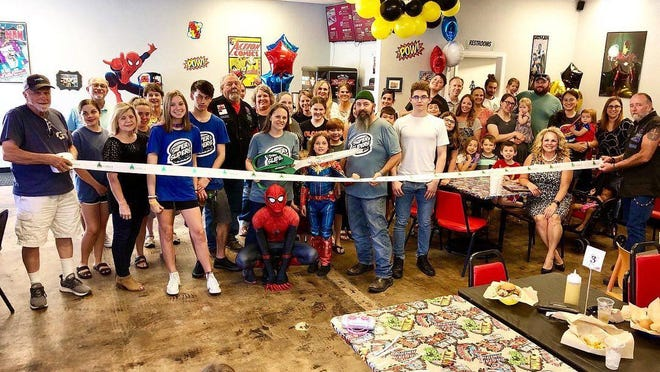 Super Sliders takes part in ribbon cutting.