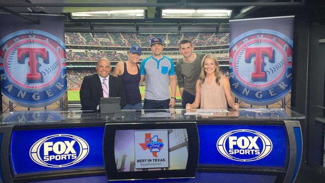 Before a Texas Rangers pregame show, Erin Hartigan (far right) and Hall of Fame catcher Pudge Rodriguez, sandwich sister Amy Krupski, brother-in-law Mickey Krupski, and fiance William Wilkerson.