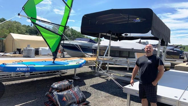 Steve Donahue Jr., owner of Precision Water Sports in Gardner, said his business is having trouble keeping up with the demand this summer.