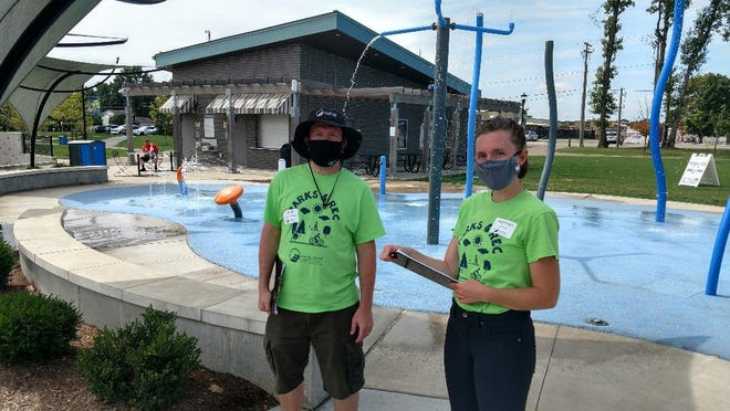Keith Rodenhauser (left) and Hannah Crepps, of engineering firm Brandstetter Carroll conducted in-person surveys with Green Parks visitors Sept. 2 and Sept. 3, part of the city's ongoing parks master plan development.