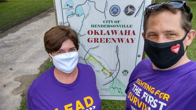 Bryan Byrd, right, team captain of #SafeHendo, walked on the Oklawaha Greenway in Hendersonville.