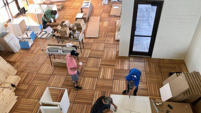 IKEA managers volunteered their time to put together furniture the company donated to the center.