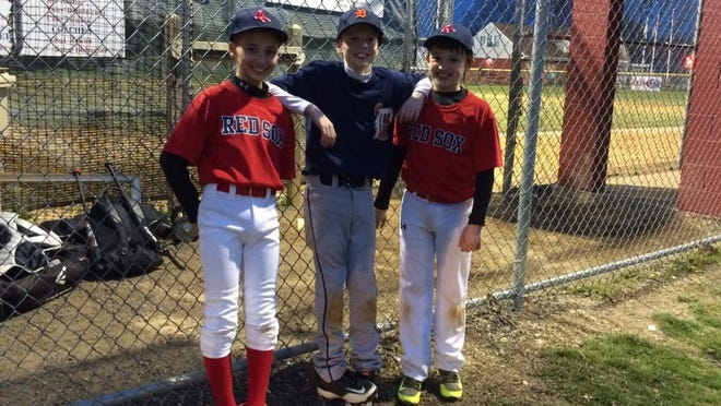 Three members of the Berkeley Little League 10-year-old All-Star team.