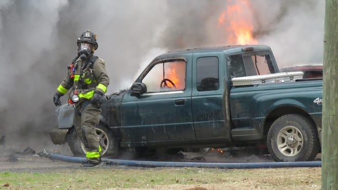 The Escambia County firefighters working is currently working a  Jan. 1, 2015 fire.
