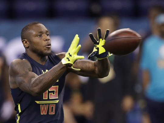 Clemson wide receiver Artavis Scott catches a pass at the NFL Scouting Combine on Saturday.