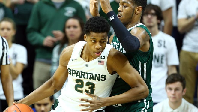 Michigan State forward Deyonta Davis (23) posts up Eastern Michigan center James Thompson IV (2) during the 1st half of MSU's win Monday at Breslin Center.