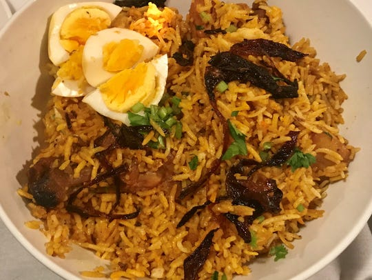 Chicken biryani, slow cooked rice with worldly spices