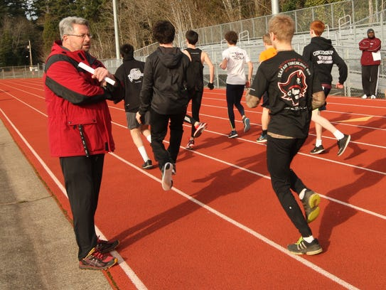 South Kitsap track and field coach Ed Santos spent
