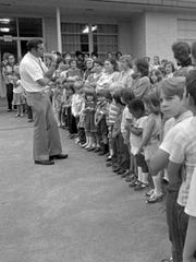 Clyde Holloway (left) addresses parents and students at Forest Hill Elementary School. Holloway, who would go on to serve in Congress, first entered public life by leading opposition to a 1980 federal busing order on the grounds that it would close the school.