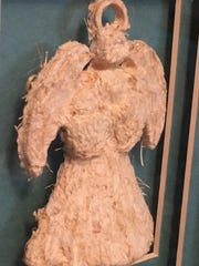 An angel is among the Carol Ann Oster wheat straw pieces
