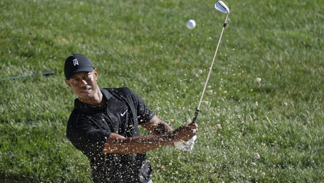 Tiger Woods hits out of a bunker on the 15th hole during a practice round for the Memorial tournament on Tuesday, July 14, 2020, in Dublin, Ohio.