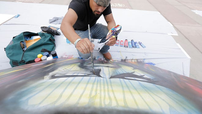 Artist Robert Garcia paints a portrait of Rob Zombie during the 2015 El Paso Downtown StreetFest. The festival will once again feature live artists on Friday and Saturday in Downtown.