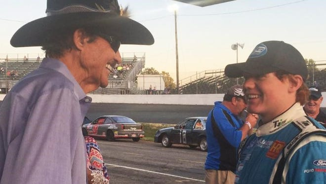 Richard Petty, left, and his 16-year-old grandson Thad Moffitt talk at the racetrack. Moffitt will make his ARCA Racing Series debut at Fairgrounds Nashville Speedway on Saturday in the Music City 200.