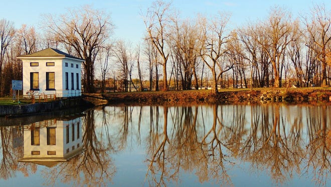 """""""Somber Reflections, Henrietta,"""" by Claire Talbot of Henrietta placed third in the """"Bridges, Buildings and Locks"""" category."""