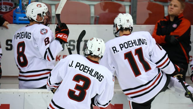 St. Cloud State freshmen Nick Poehling, Jack Poehling and Ryan Poehling return to the bench after their shift on the ice during the first period of the Friday, Oct. 28, game at the Herb Brooks National Hockey Center in St. Cloud.