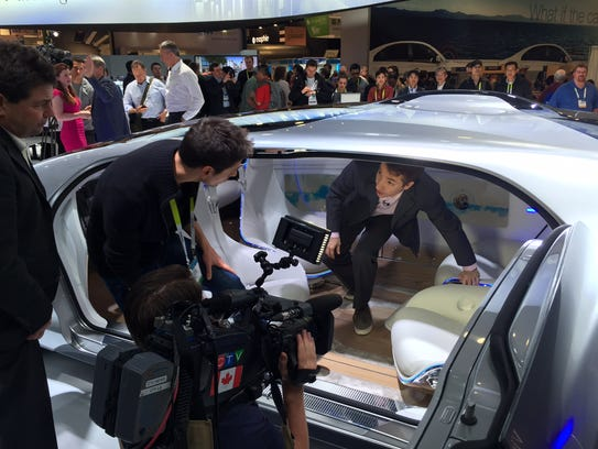 Reporters from all over the world mob the Mercedes-Benz