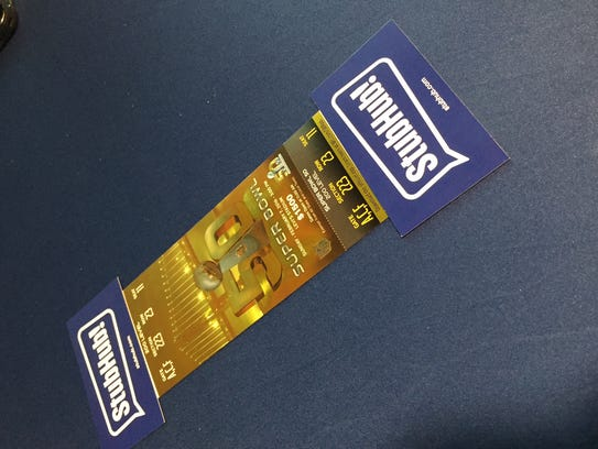 A Super Bowl 50 ticket, with the bar codes covered