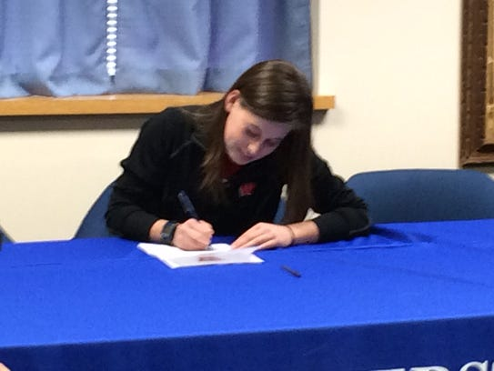 Amherst senior Alissa Niggemann signs a letter of intent